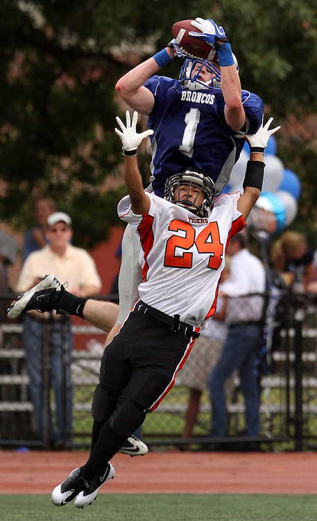 Bronxville's Matt Tormey makes a leaping catch for major yards above Tuckahoe's Alex Alvarado during the football game between the two state champs at Bronxville High School on Sept. 24, 2011. Bronxville beat Tuckahoe 33-12. ( Xavier Mascareñas / The Journal News )