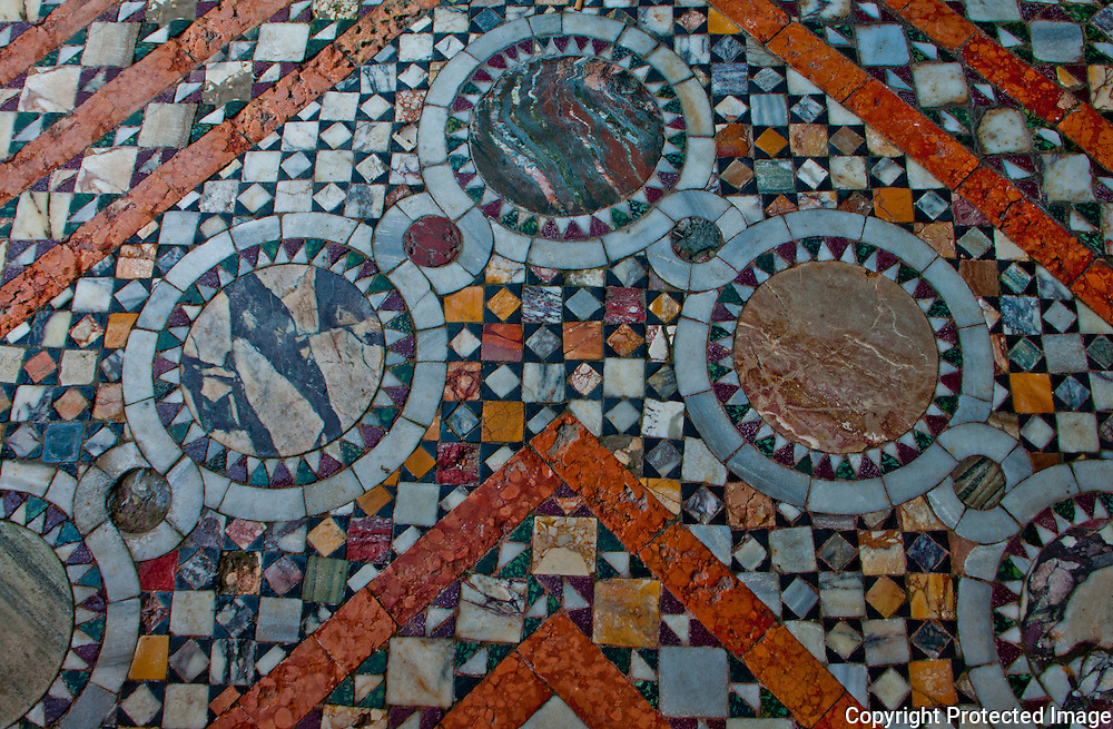 Detail of a beautiful colored natural stone mosaic floor in a palazzo in Venice, Italy.