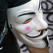 Close up of &quot;Anonymous&quot; mask on protester's arm, at the &quot;Animal Rights March 2018&quot; in NYC.<br /> <br /> Anonymous is a group initiating active civil disobedience and spread through the Internet while staying hidden, representing the concept of many online community users simultaneously existing as an anarchic, digitized global brain. <br /> <br /> It is also generally considered to be a blanket term for members of certain Internet subcultures, a way to refer to the actions of people in an environment where their actual identities are not known.