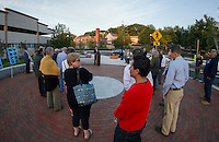 Mayor Ed Engler speaks to the crowd gathered for the official ribbon cutting at the Laconia Main Street Bridge and Gateway Plaza Friday evening.  (Karen Bobotas/for the Laconia Daily Sun)