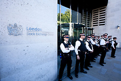 © Licensed to London News Pictures. 15/10/2011. LONDON, UK. City of London Police guard an entrance to the London Stock Exchange during the Occupy London protest. Photo credit: Matt Cetti-Roberts/LNP