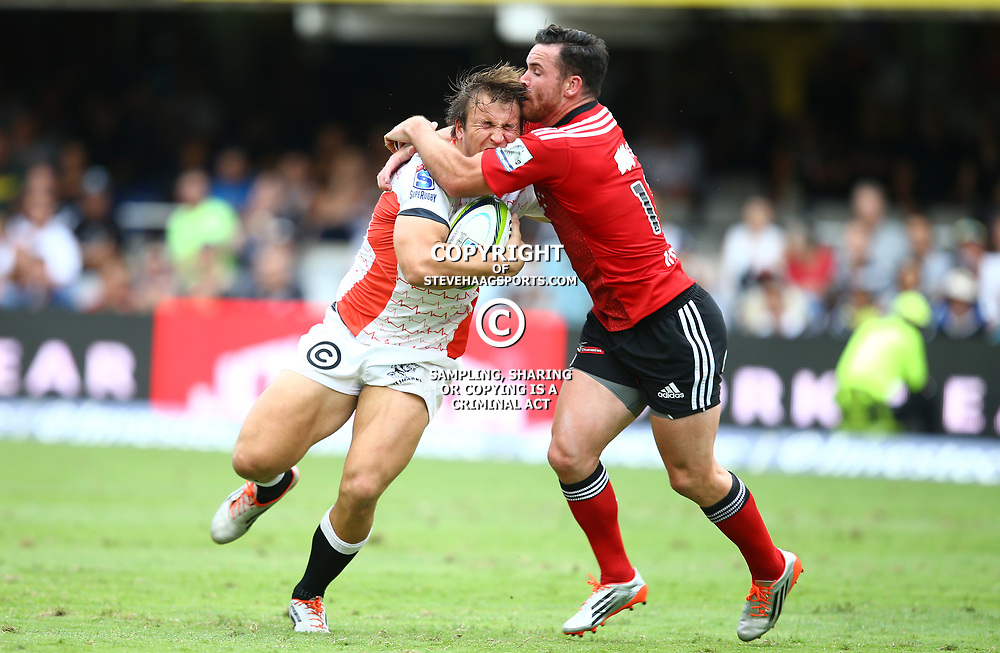 DURBAN, SOUTH AFRICA - APRIL 04: Ryan Crotty of the Crusaders tackling  Andre Esterhuizen of the Cell C Sharks during the Super Rugby match between Cell C Sharks and Crusaders at Growthpoint Kings Park on April 04, 2015 in Durban, South Africa. (Photo by Steve Haag/Gallo Images)