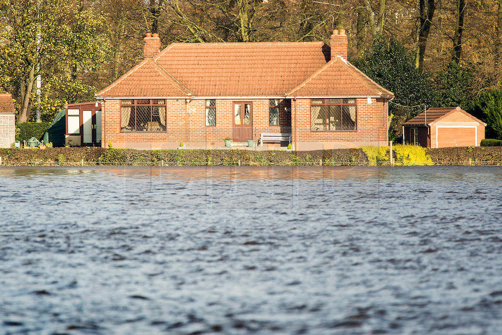 © Licensed to London News Pictures. 16/11/2015. Tadcaster UK.  The River Wharfe in Tadcaster has broken it's banks & flooded football fields & surrounding farm land after the weekends heavy rain. Photo credit: Andrew McCaren/LNP
