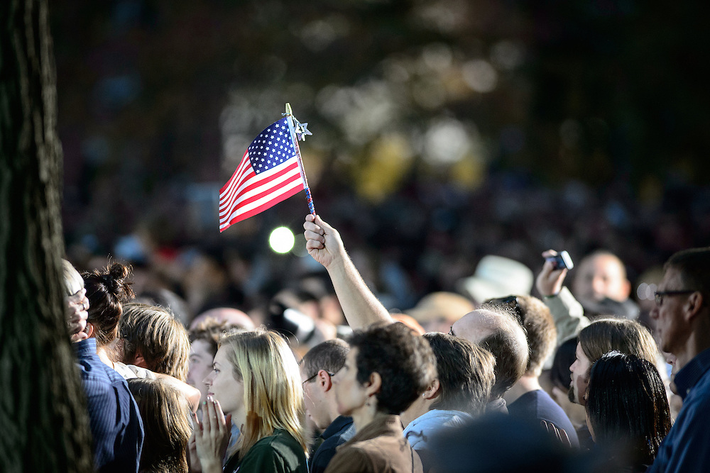 A flag is seen waving above the crowd during Barack Obama's speech on Ohio University's College Green in Athens, Ohio, on Wednesday, October 17, 2012.  (© 2012 Brien Vincent)