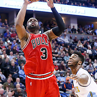 22 November 2016: Chicago Bulls guard Dwyane Wade (3) goes for the layup past Denver Nuggets guard Emmanuel Mudiay (0) during the Denver Nuggets 110-107 victory over the Chicago Bulls, at the Pepsi Center, Denver, Colorado, USA.