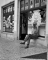 Street Photography. Afternoon Walkabout in Lisbon. Image taken with a Nikon 1 V3 camera with a 10-30 mm OIS lens.