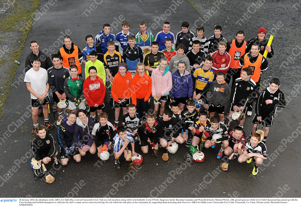 26 January 2013; In attendance at the AIB GAA Skills Day event at Clarecastle GAA Club are club members along with Cork footballer Colm O'Neill, Tipperary hurler Brendan Cummins and Waterford hurler Michael Walsh. AIB, proud sponsors of the GAA Club Championships joined up with the Clare hurling and football champions to celebrate the club's county success and acknowledge the role which the club plays in the community by supporting them in hosting their first ever AIB GAA Skills event. Clarecastle GAA Club, Clarecastle, Co. Clare. Picture credit: Diarmuid Greene / SPORTSFILE
