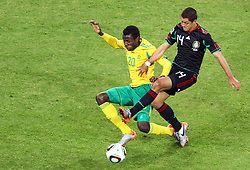South Africa's Bongani Khumalo vs Mexico's Javier Hernandez during the Group A first round 2010 FIFA World Cup South Africa match between South Africa and Mexico at Soccer City Stadium on June 11, 2010 in Johannesburg, South Africa.  (Photo by Vid Ponikvar / Sportida)