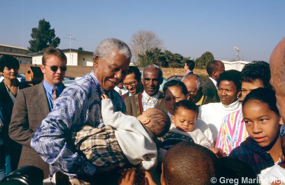 Northern Cape, South Africa 1994: Nelson Mandela greets children at a pre-election rally ahead of South Africa's first democratic elections in 1994.