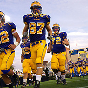 Delaware player take the field to open the 2010-11 Season against West chester University golden rams at delaware stadium. No. 16 Hens would go on to a 31-0 victory in the season opener at Delaware Stadium. ......