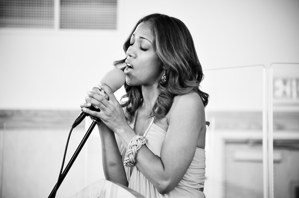 The singer during Cassie & Ernest's ceremony at Covenant United Church of Christ in South Holland, IL