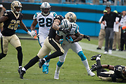 Cutis Samuel(10) is tackled after making a first down in the New Orleans Saints 34 to 13 victory over the Carolina Panthers.