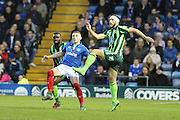 Jon Meades of AFC Wimbledon and Caolan Lavery battle during the Sky Bet League 2 match between Portsmouth and AFC Wimbledon at Fratton Park, Portsmouth, England on 15 November 2015. Photo by Stuart Butcher.