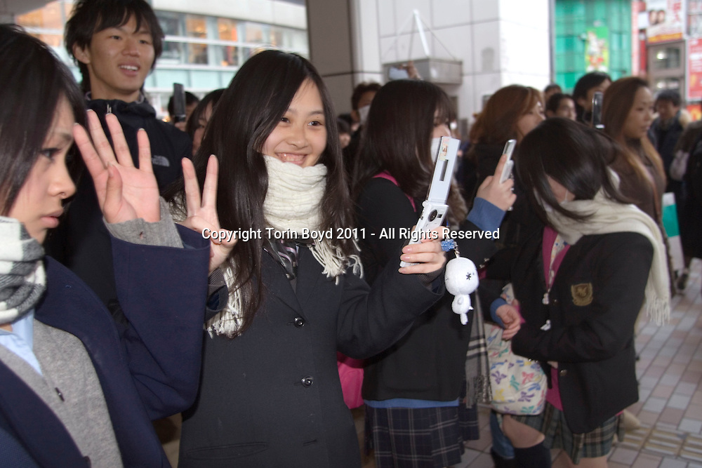 This view shows Japanese TV celebrities during an impromptu charity drive to solicit donations for aid victims of the massive earthquake and tsunami that struck Japan on March 11, 2011. This took place in front of Tokyo's Shinjuku Station during rush hour on March 17, 2011. Tokyo is on full alert concerning extremely dangerous radiation threats and the metropolis is also on scheduled brownouts with minimal rail and subway service. As such, this event was a welcomed refresher for those who encountered it.