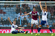 Aston Villa defender Tommy Elphick (24) claims to have won the ball, as Middlesbrough forward Patrick Bamford (11) and Middlesbrough midfielder Marcus Tavernier (62) appeal for the penalty during the EFL Cup match between Aston Villa and Middlesbrough at Villa Park, Birmingham, England on 19 September 2017. Photo by Simon Davies.