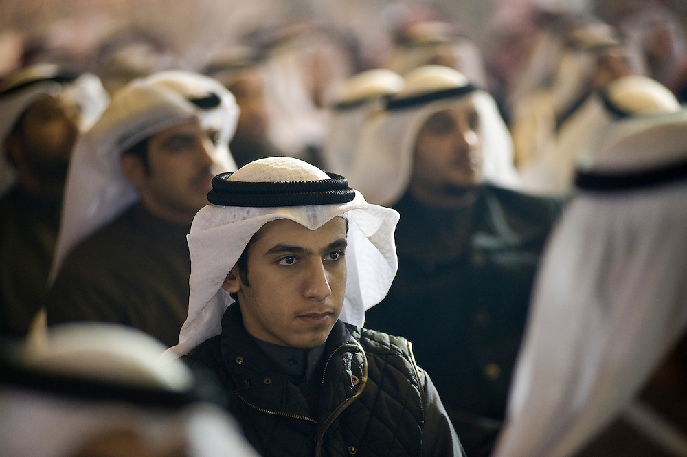 A young Kuwaiti looks on during a Jan. 23 election rally near Kuwait City organized by candidate Anwar Al-Dahoum.  More than 400,000 Kuwaiti men and women are eligible to cast ballots to choose from among some 320 men and women candidates currently in the running in the February 2, 2012 parliamentary polls to elect a new 50-member National Assembly (parliament).