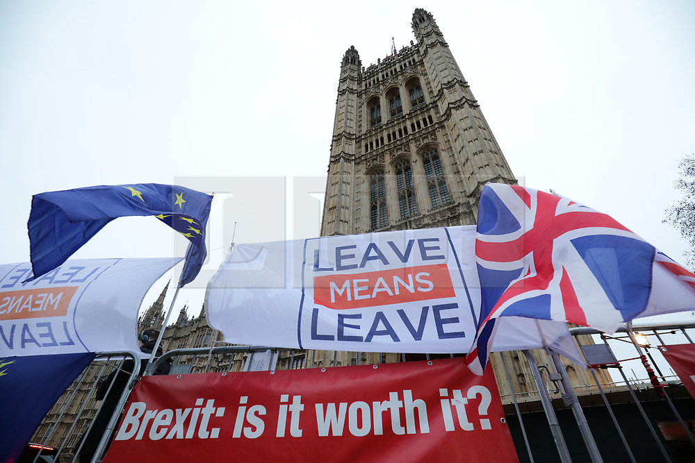 © Licensed to London News Pictures. 15/01/2019. London, UK. Pro- and anti-Brexit banners hung opposite Parliament. MPs will vote on Prime Minister Theresa May's Brexit deal this evening. Photo credit: Rob Pinney/LNP