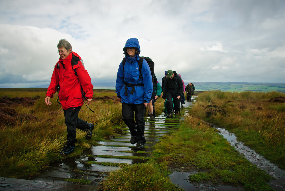 Walkers led by Colin Speakman walk to the 12 Apostles at the South Pennine Walk and Ride Festival, 2010, at Ilkley, Yorkshire Dales,Uk