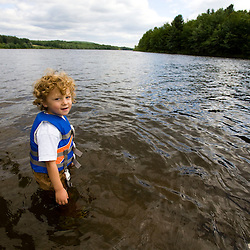 A young boy (age 4) plays in the Androscoggin River in Turner, Maine. (MR)