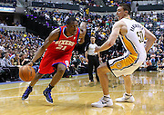 March 14, 2012; Indianapolis, IN, USA; Philadelphia 76ers forward Thaddeus Young (21) dribbles the ball against Indiana Pacers power forward Tyler Hansbrough (50) at Bankers Life Fieldhouse. Indiana defeated Philadelphia 111-94. Mandatory credit: Michael Hickey-US PRESSWIRE