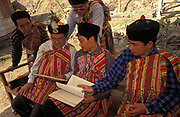 "Elders from the Lepcha community look at written documents during a gathering during which they celebrate their culture and language while discusing their loss of identity, on 18th June 1995, in Kalimpong, West Bengal, India. The Lepcha are also called the Rongkup meaning the children of God and the Rong, Mutunci Rongkup Rumkup ""beloved children of the Rong and of God""), and Rongpa are among the indigenous peoples of Sikkim, India and number between 30,000 and 50,000. Many Lepcha are also found in western and southwestern Bhutan, Tibet, Darjeeling, the Mechi Zone of eastern Nepal, and in the hills of West Bengal."