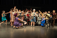 Thoroughly Modern Millie (Kate Persson) is surrounded by the cast at Laconia Middle School during dress rehearsal Wednesday afternoon.  (Karen Bobotas/for the Laconia Daily Sun)