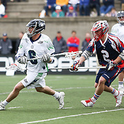 Ben Rubeor #6 of the Chesapeake Bayhawks keeps the ball away from Scott Ratliff #2 of the Boston Cannons during the game at Harvard Stadium on April 27, 2014 in Boston, Massachusetts. (Photo by Elan Kawesch)