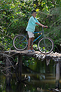 Phu Quoc Island. Bai Thom. Boy on a bicycle.