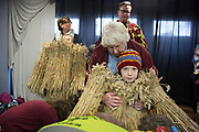 UNITED KINGDOM, Whittlesey: Straw Bear Festival. Grace Randall, aged 11 (left) and Jasper Fell, aged 6 (right) get dressed as 'The Bear', traditionally a mischievous straw character before dancing through the streets of Whittlesey during the Straw Bear festival this weekend. The three day festival, which originated in 1882, consists of traditional Molly, Morris, Clog and Sword dancing as well as parading a large straw character known as 'The Bear' through the town. Rick Findler  / Story Picture Agency