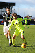 Hibernian midfielder Ryan Gauld (13) on the ball and chased down by St Mirren midfielder Stephen McGinn (4)  during the Ladbrokes Scottish Premiership match between St Mirren and Hibernian at the Paisley 2021 Stadium, St Mirren, Scotland on 27 January 2019.