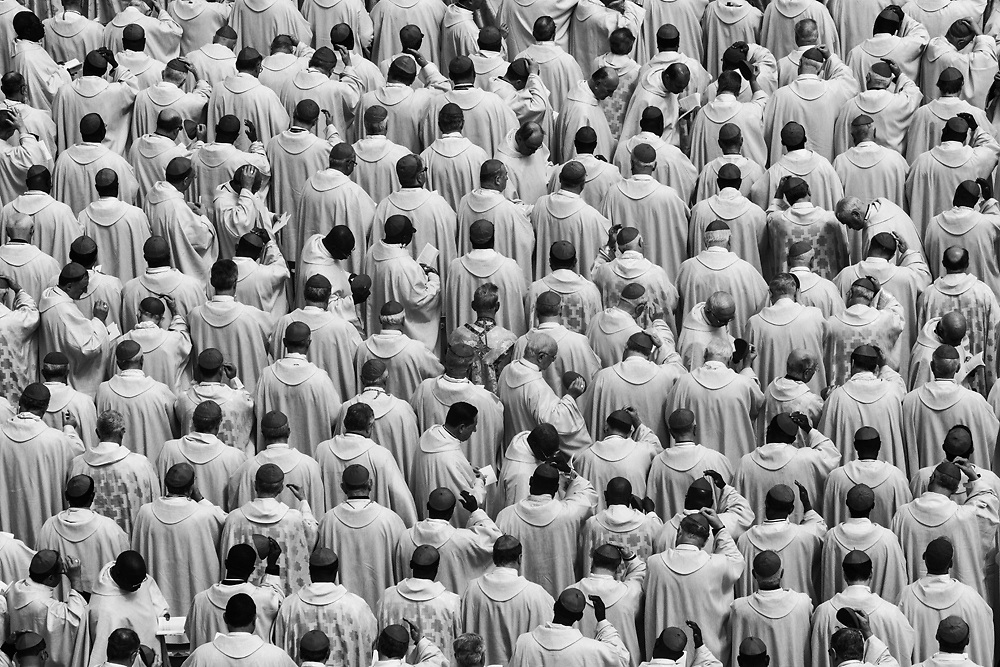 Black & White Portfolio: Priests and Bishops  gather in St. Peter's Square during the historical canonization of Jonh Paul II and John XXIII.The double canonisation of two of modern-day Catholicism's most influential figures was presided over by Pope Francis and was attended by his elderly predecessor Benedict XVI, bringing two living pontiffs together to celebrate two deceased predecessors.