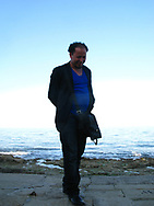 Man near the Mediterranean Sea in Marzamemi, Sicily, Italia 2012