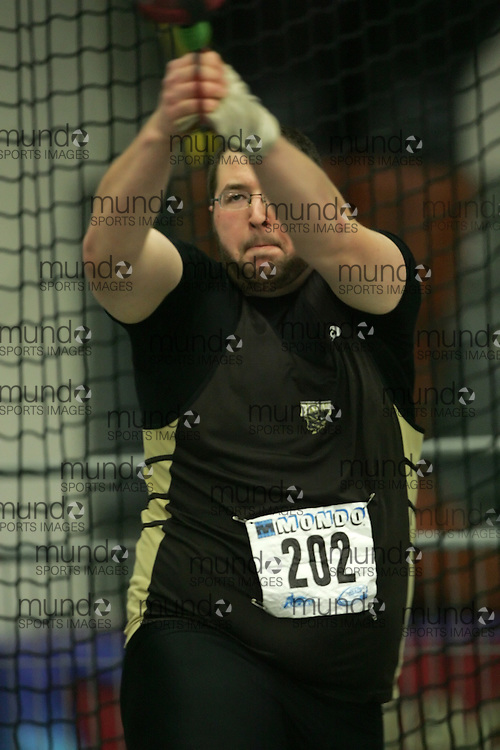 (Windsor, Ontario---12 March 2010) Justin Charrier of University of Manitoba   competes in the  at the 2010 Canadian Interuniversity Sport Track and Field Championships at the St. Denis Center. Photograph copyright Sean Burges/Mundo Sport Images. www.mundosportimages.com