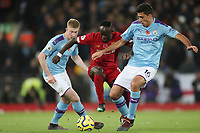 Football - 2019 / 2020 Premier League - Liverpool vs. Manchester City<br /> <br /> Sadio Mane of Liverpool competes with Rodri of Manchester City, at Anfield.<br /> <br /> COLORSPORT/PAUL GREENWOOD