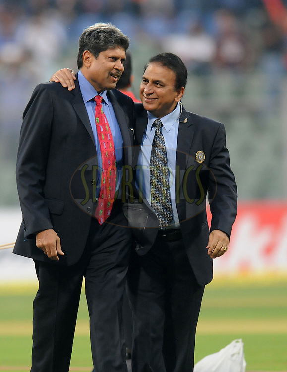 Indian former cricketers and commentators Kapil Dev (L) and Sunil Gavaskar are seen during a lighter moment before the start of the second Airtel T20 Match between India and England held at Wankhede stadium in Mumbai on the 22th December 2012..Photo by  Pal Pillai/BCCI/SPORTZPICS .