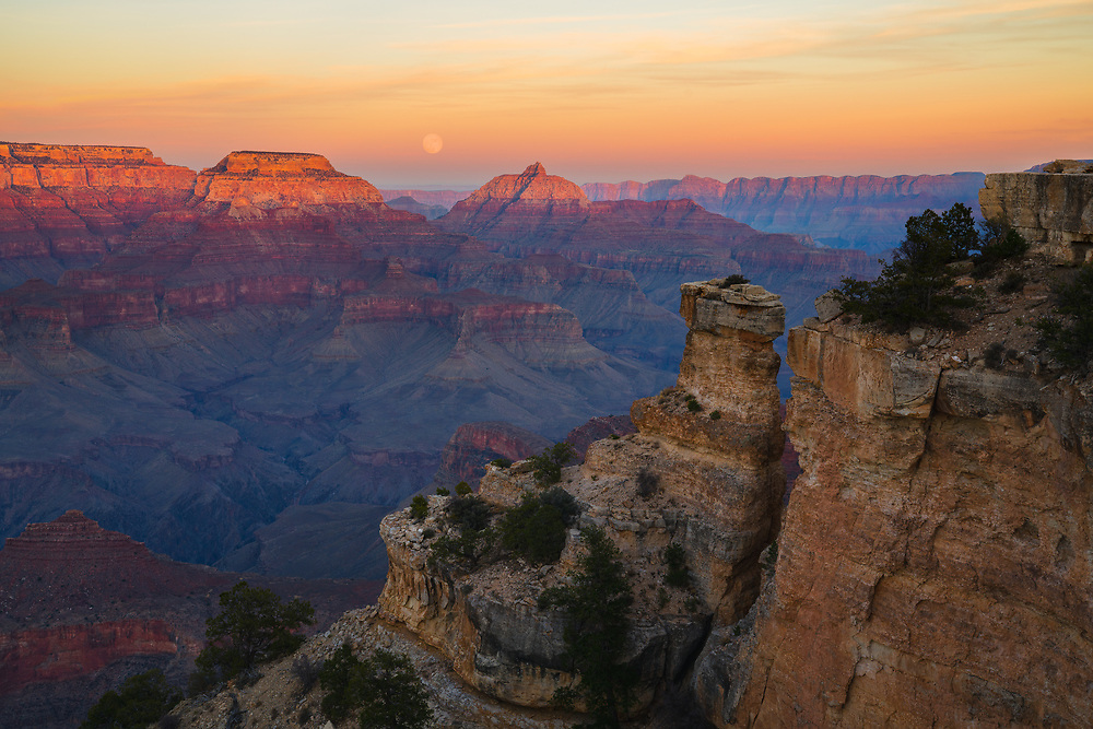 A full moon rises over the Grand Canyon. From Yaki Point on the South Rim of Grand Canyon National Park in Arizona.