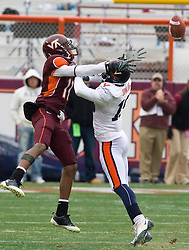 Virginia cornerback Ras-I Dowling (19) was called for pass interference for contact made with Virginia Tech wide receiver Dyrell Roberts (11) during a pass play.  The Virginia Tech Hokies defeated the Virginia Cavaliers 17-14 in NCAA football at Lane Stadium on the campus of Virginia Tech in Blacksburg, VA on November 29, 2008.