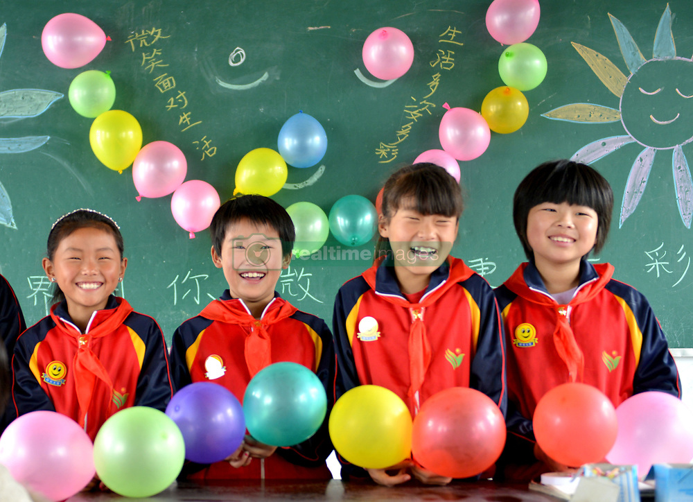 May 7, 2018 - Shangqiu, Shangqiu, China - Shangqiu, CHINA-7th May 2018: Pupils smile at a World Smile Day campaign in Shangqiu, central China's Henan Province. World Smile Day is celebrated on May 8th every year. (Credit Image: © SIPA Asia via ZUMA Wire)