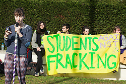 Windsor, UK. 22nd February, 2019. A speaker from Reclaim the Power addresses around 60 campaigners from Reclaim the Power and Fuel Poverty Action who set up a mock fracking site during a family-friendly protest outside the headquarters of Centrica to call on the British multinational energy and services company to cease its support for fracking operations through its partnership with shale gas company Cuadrilla Resources.