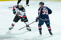 KELOWNA, BC - FEBRUARY 12: Booker Daniel #39 of the Tri-City Americans stick checks Dylan Wightman #28 of the Kelowna Rockets in third period at Prospera Place on February 8, 2020 in Kelowna, Canada. (Photo by Marissa Baecker/Shoot the Breeze)