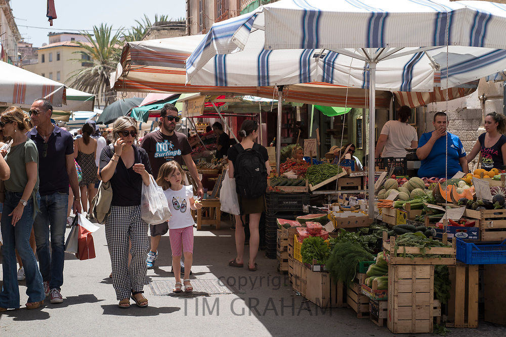 Shoppers and market stalls at old street market - Mercado -  in Ortigia, Syracuse, Sicily
