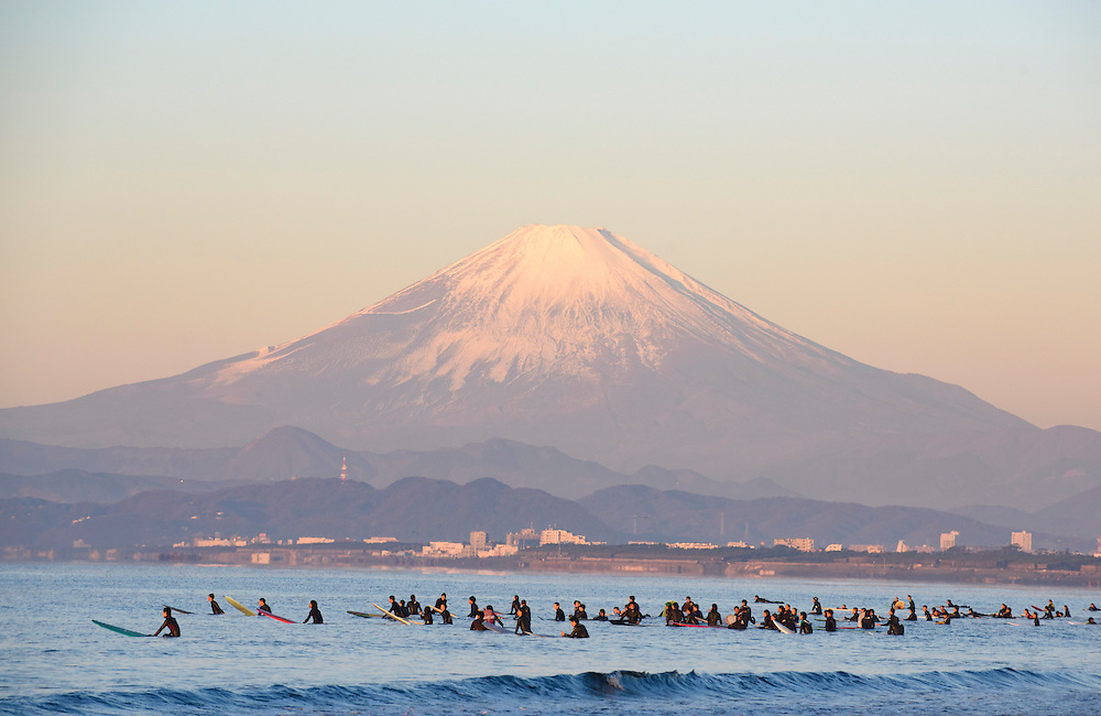 Surfers watch the first sunrise of the new year, known in Japan as 'hatsu-hinode' from a beach in Fujisawa, Kanagawa prefecture, Japan.