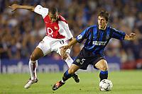 Fotball<br /> UEFA Champions League 2003/2004<br /> Arsenal v Inter<br /> 17.09.2003<br /> NORWAY ONLY<br /> Foto: Digitalsport<br /> <br /> FOOTBALL - CHAMPIONS LEAGUE 2003/04 - 1ST ROUND - GROUP B - 030917 - ARSENAL FC v FC INTERNAZIONALE - EMRE BELOZOGLU  (INT) / GILBERTO SILVA (ARS) - PHOTO LAURENT BAHEUX
