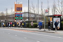 © Licensed to London News Pictures. 31/03/2020. London, UK. Shoppers queue to enter Sainsbury's supermarket in Charlton South east London. The Government has announced a lockdown to slow the spread of Coronavirus and reduce pressure on the NHS. Photo credit: George Cracknell Wright/LNP