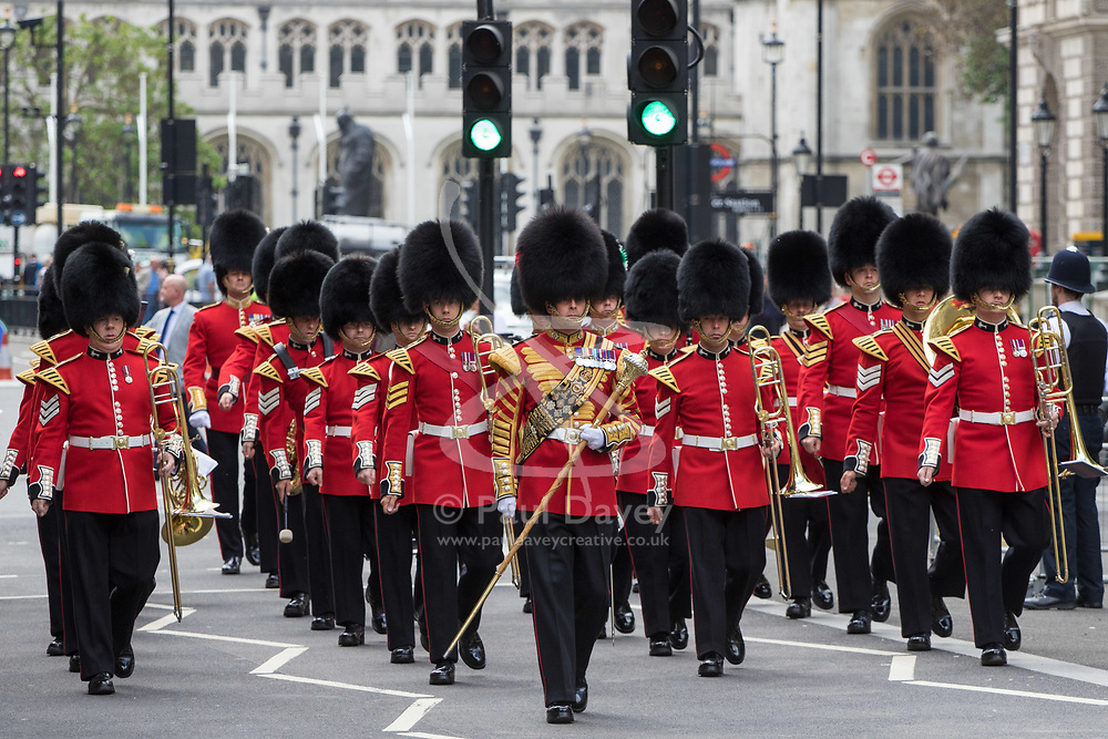 Whitehall, London, May 24th 2017.  Wreaths are laid at the Cenotaph on Whitehall in London as The Band of the Welsh Guards and the Colour Guard of the United Nations Veterans Association lead members of the diplomatic corps and wreath layers from The Royal United Services Institute as they observe The International day of United Nations Peacekeepers, amid tight security. PICTURED: The welsh Guards band marches into Whitehall.