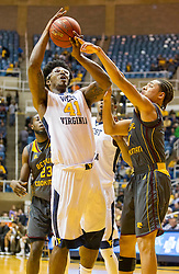 Nov 23, 2015; Morgantown, WV, USA; West Virginia Mountaineers forward Devin Williams makes a move in the lane during the first half against the Bethune-Cookman Wildcats at WVU Coliseum. Mandatory Credit: Ben Queen-USA TODAY Sports