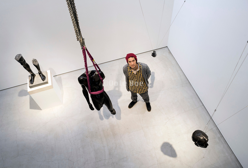artist Sequoyah Aono with his sculpture installation at the Loko Gallery in Tokyo November <br /> 2018