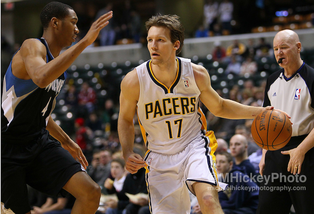 Feb. 11, 2011; Indianapolis, IN, USA; Indiana Pacers forward Mike Dunleavy (17) dribbles against Minnesota Timberwolves small forward Wesley Johnson (4) at Conseco Fieldhouse. Mandatory credit: Michael Hickey-US PRESSWIRE