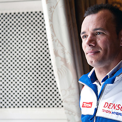 Stephane Sarrazin, who will be driving the Toyota TS030 hybrid, looking out of the window of the Royal Automobile Club contemplating the first race at Silverstone at the FIA-WEC series launch London on the 22nd March 2013. WAYNE NEAL | STOCKPIX.EU