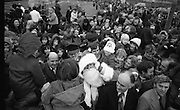 Santa at Crumlin Shopping Centre <br /> 27/11/1976<br /> 11/27/1976<br /> 27th November 1976<br /> Crowds of children and parents mob Santa Claus on his visit to Crumlin Shopping Centre.